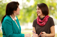a counselor meeting with a young woman