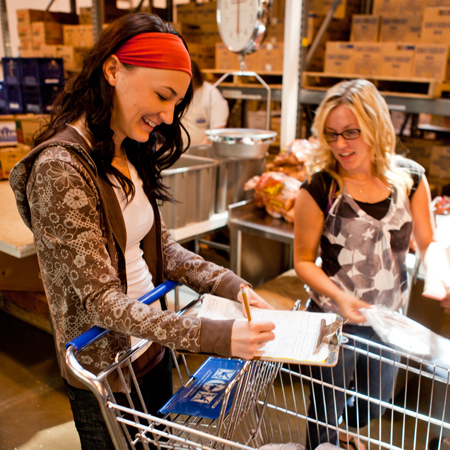 Woman fills out food order at bishops storehouse